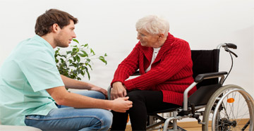 Man speaking with elderly woman